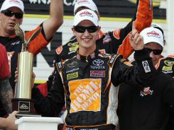 Joey Logano celebrates his second career Cup win at Pocono Raceway.