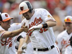 Matt Wieters celebrates his game-winning RBI that propelled the Orioles over the Phillies.