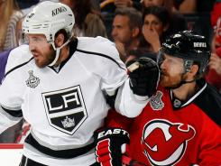 Devils defenseman Henrik Tallinder, right, battles Kings forward Mike Richards for position during Game 5.
