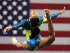 Gabrielle Douglas warms up during the final day of the 2012 Visa Championships on Sunday in St. Louis.