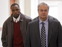 Former Broncos cornerback Perrish Cox, left, arrives at district court with attorney Harvey Steinberg for his sexual assult trial in February. He was acquitted.