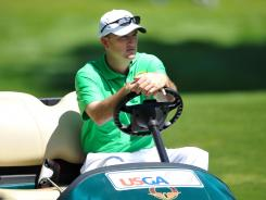 Casey Martin rides in a golf cart during a practice round Monday before the 112th U.S. Open.