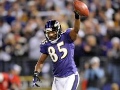Derrick Mason celebrates a touchdown reception against the Pittsburgh Steelers at M&T Bank Stadium in Baltimore on Nov. 29, 2009.
