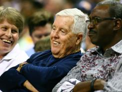 Grizzlies owner Michael Heisley, center, watches an April 14 game against the Jazz. He has agreed to sell the team to Robert J. Pera.