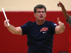 A female NBA security officer is suing Geno Auriemma, the coach of the U.S. Olympic women's basketball team, for employment discrimination.