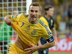 Ukrainian forward Andriy Shevchenko celebrates after scoring his second goal during the Euro 2012 soccer championship Group D match.