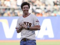 Defending U.S. Open champion Rory McIlroy threw out the ceremonial first pitch at the San Francisco Giants-Houston Astros game Tuesday.