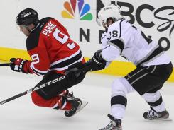 The Devils and Kings have two hard-to-replace free agents in Zach Parise, left, and Jarret Stoll.