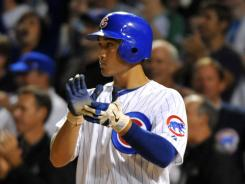 Cubs second baseman Darwin Barney celebrates scoring a run against the Tigers during the eighth inning at Wrigley Field.