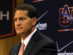"Auburn football coach Gene Chizik says counseling was made available to players hours after the shooting. ""It's hard to navigate these uncharted waters. It's hard enough for grown adults . . . and we've got a whole team trying to figure this out."""