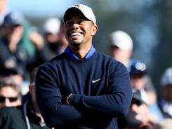 Tiger Woods flashes a smile Tuesday during a practice round for the 112th U.S. Open at The Olympic Club in San Francisco.