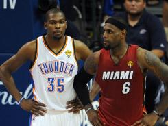 Thunder forward Kevin Durant, left, and Heat forward LeBron James led their teams in scoring Tuesday in Game 1 of the NBA Finals.