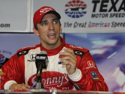 Justin Wilson meets with the news media after winning at Texas Motor Speedway with illegal parts.
