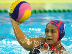 Brenda Villa of the United States looks to pass against the Netherlands as they play to a 7-7 draw in the opening match at the 14th FINA World Championships on July 17, 2011, in Shanghai.