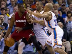 Miami's Dwyane Wade, left, and Oklahoma City's Russell Westbrook, middle, will be two important backcourt performers in the NBA Finals.
