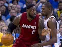 Heat forward LeBron James posts up on Thunder forward Kevin Durant in a March 25 Oklahoma City home win. They meet again in the 2012 NBA Finals.
