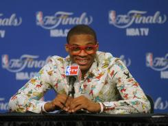Oklahoma City Thunder point guard Russell Westbrook talks during a postgame news conference, sporting one of his crazy-looking shirts.