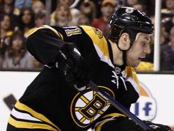 Boston Bruins center Gregory Campbell agreed to a three-year deal.