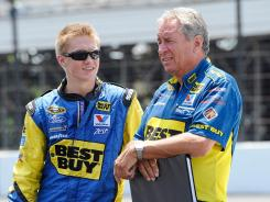 Crew chief Jimmy Fennig, right, and son Joey work together on Matt Kenseth's No. 17 team for Roush Fenway Racing.