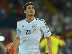 German forward Mario Gomez celebrates after scoring a goal against the Netherlands. Gomez has three goals in the tournament.