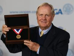 Jack Nicklaus poses with the newly named 'USGA Jack Nicklaus gold medal' to be awarded to the U.S. Open Champion starting with the 112th tournament that begins Thursday.