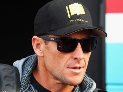 Lance Armstrong attends the 2012 Paris Roubaix cycle race from Compiegne to Roubaix on April 8 in Paris.