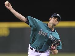 Seattle Mariners reliever Tom Wilhelmsen pitches in the ninth inning of a combined no-hitter against the Los Angeles Dodgers at Safeco Field on June 8, 2012 in Seattle.