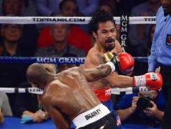 Timothy Bradley Jr hits Manny Pacquiao during a welterweight championship bout in Las Vegas on Saturday.