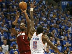 Miami Heat forward Chris Bosh, No. 1 in red, might be asked to go 40-plus minutes Thursday in Game 2 vs. the Oklahoma City Thunder, his longest stint since returning from a lower abdominal muscle strain.