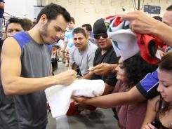 Julio Cesar Chavez Jr. signs autographs this week in El Paso, where Chavez, a fan favorite, will fight Andy Lee.