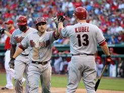 Arizona Diamondbacks catcher Miguel Montero (center) celebrates after scoring in the third inning with designated hitter Jason Kubel (13).