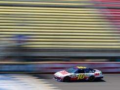 Greg Biffle drives during NASCAR Sprint Cup Series testing at Michigan International Speedway. Biffle has eight top-10 finishes this season.