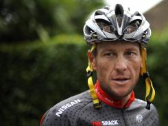 A file photo taken July 21, 2010, shows Lance Armstrong arriving to take part in a training session during the second of the two rest days of the 2010 Tour de France.