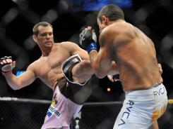 UFC fighters Rich Franklin, left, and Vitor Belfort fight on Sept. 19, 2009 in Dallas.