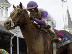 Mario Gutierrez rides I'll Have Another to victory in the 138th Kentucky Derby at Churchill Downs.