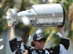 Kings center Anze Kopitar holds up the Stanley Cup during the team's championship parade and celebration Thursday in Los Angeles.