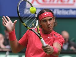 Rafael Nadal of Spain advances with a smooth victory against hits Lukas Lacko of Slovakia.