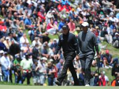 Phil Mickelson and Tiger Woods walk to the No. 8 green, their final hole of the day, on Thursday at the U.S. Open at The Olympic Club.