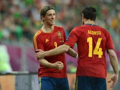 Spanish forward Fernando Torres (L) celebrates with Spanish midfielder Xabi Alonso after scoring vs Republic of Ireland during the Euro 2012 championships on June 14, 2012.
