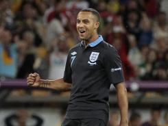 England's Theo Walcott celebrates after scoring during a Euro 2012 match against Sweden in Kiev, Ukraine.