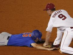 Florida's Justin Shafer (16) gets picked off second base by South Carolina shortstop Joey Pankakea in the eighth inning of an NCAA college baseball game during the Southeastern Conference tournament in Hoover, Ala., back in late May.
