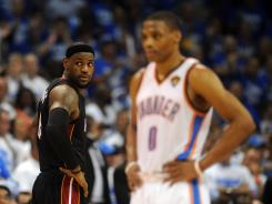 forward LeBron James (6) looks over his shoulder past Thunder guard Russell Westbrook (0) during a stop in play during the fourth quarter of Game 2.