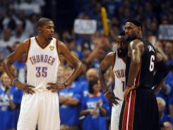 Thunder forward Kevin Durant, left, scored 32 points but was matched in that output by LeBron James, right, in Game 2 of the NBA Finals on Thursday.