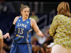 Minnesota Lynx guard Lindsay Whalen (13) talks with head coach Cheryl Reeve while playing against the Phoenix Mercury.