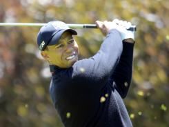 Tiger Woods launches a tee shot at No. 1 on his way to a second-round 70 and a share of the U.S. Open lead at The Olympic Club in San Francisco.