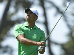 Tiger Woods' day began with a bogey and didn't get much better. He shot a 75 to fall five shots out of the lead.
