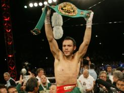 Julio Cesar Chavez Jr. celebrates his victory over Andy Lee in their WBC middleweight title bout Saturday in El Paso, Texas.