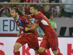 Czech midfielder Petr Jiracek (left) celebrates with forward Milan Baros after scoring a goal during the Euro 2012 match between the Czech Republic and Poland.