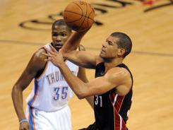 Miami Heat small forward Shane Battier, driving in Game 2 of the NBA Finals past Kevin Durant (35), has been a scoring surprise.