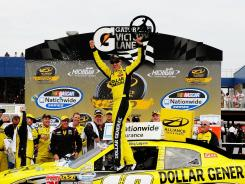 Joey Logano, driver of the Dollar General Toyota, celebrates his victory in the NASCAR Nationwide Series Alliance Truck Parts 250 at Michigan International Speedway.